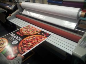 Mounting stickers with laminator